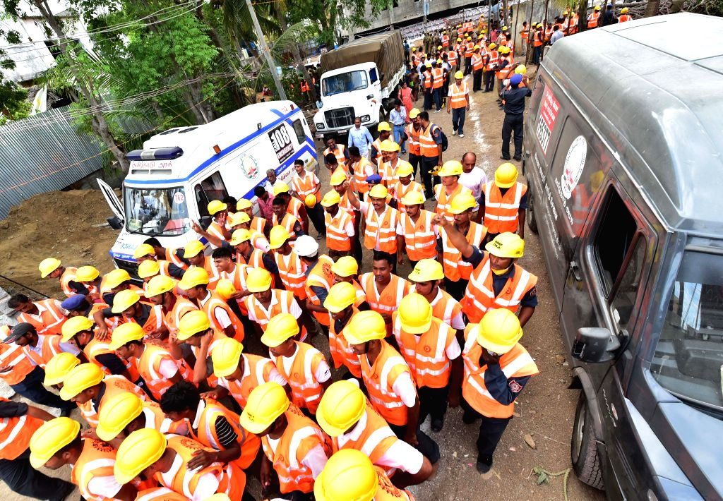 National Disaster Response Force (NDRF) leaves as rescue operations concludes at the site where a portion of an under-construction eleven-storey building collapsed killing 61 persons so far at ...