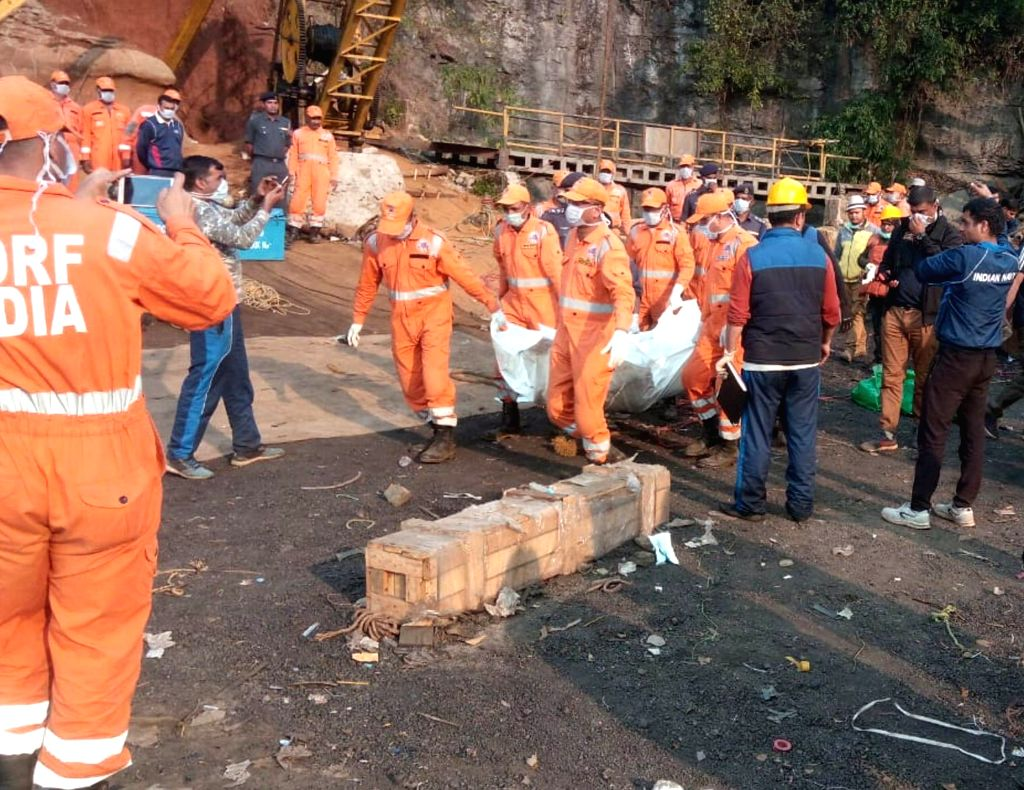 National Disaster Response Force (NDRF) personnel carry the body of a miner that was pulled out from a 370 feet deep flooded coal mine by a Navy team, in Ksan of Meghalaya's East Jaintia Hills ...