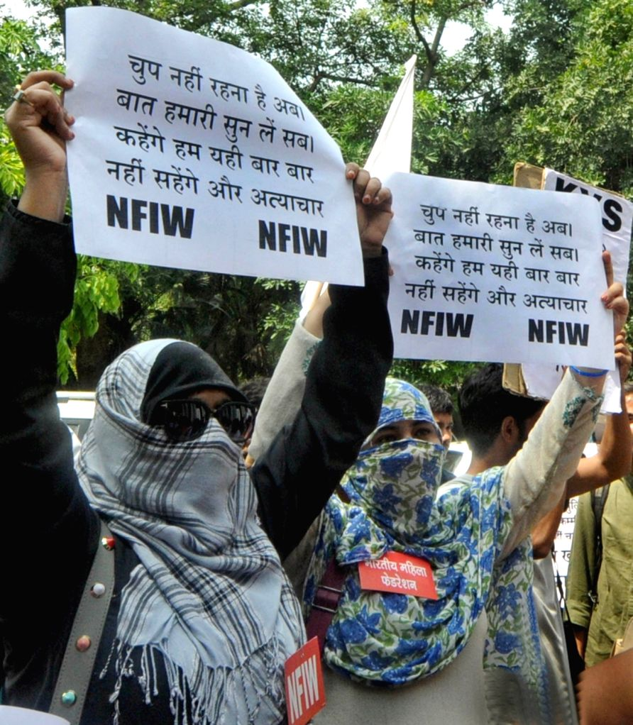 National Federation of Indian Women (NFIW) activists stage a demonstration to protest against brutal Rewari gang-rape; in New Delhi, on Sept 17, 2018.