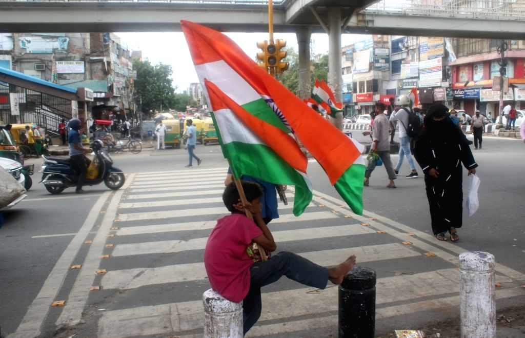 National flags being sold on the eve of the 74th Independence Day celebrations, in New Delhi on Aug 14, 2020.