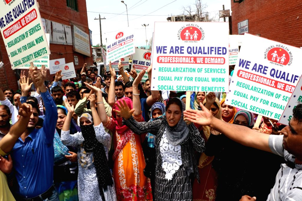National Health Mission (NHM) workers stage a demonstration to press for their demands in Srinagar on June 23, 2016.