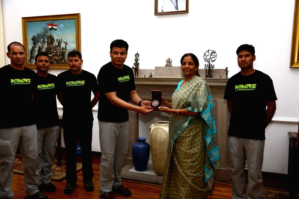National Institute for Mountaineering and Allied Sports (NIMAS), Dirang, Arunachal Pradesh Director and Team er Col. Sarfraz Singh hands over a momento to Defence Minister Nirmala ... - Nirmala Sitharaman and Sarfraz Singh
