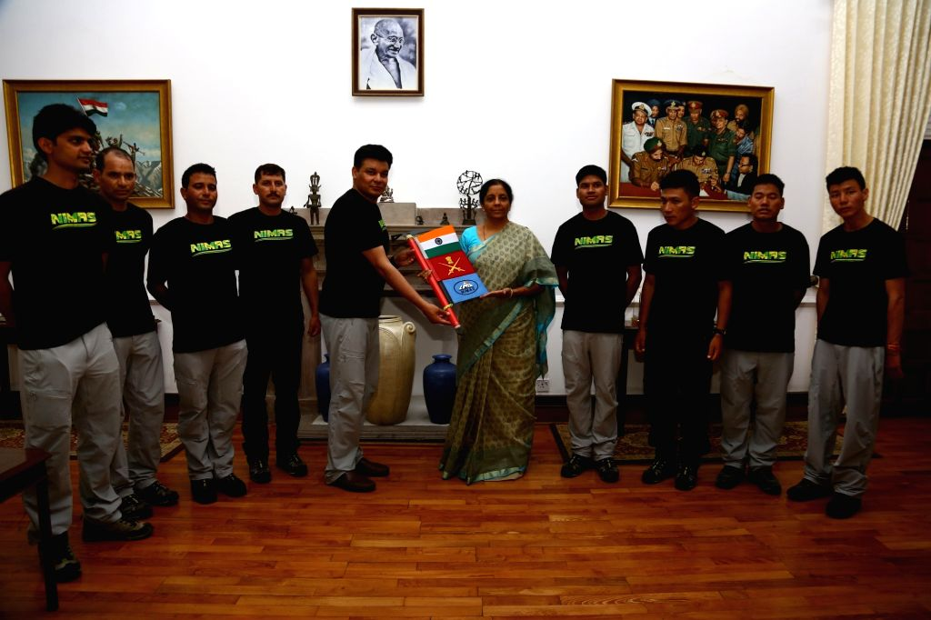 National Institute for Mountaineering and Allied Sports (NIMAS), Dirang, Arunachal Pradesh Director and Team er Col. Sarfraz Singh hands over the expedition ice axe along with flags to ... - Nirmala Sitharaman and Sarfraz Singh
