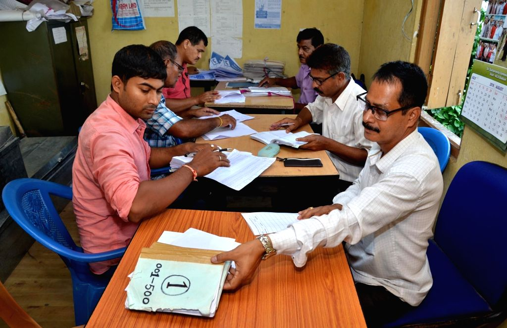National Register of Citizens (NRC) officials busy with the publication of the final draft of updated NRC for Assam at NRC Seva Kendra, in Guwahati on  July 24, 2018.
