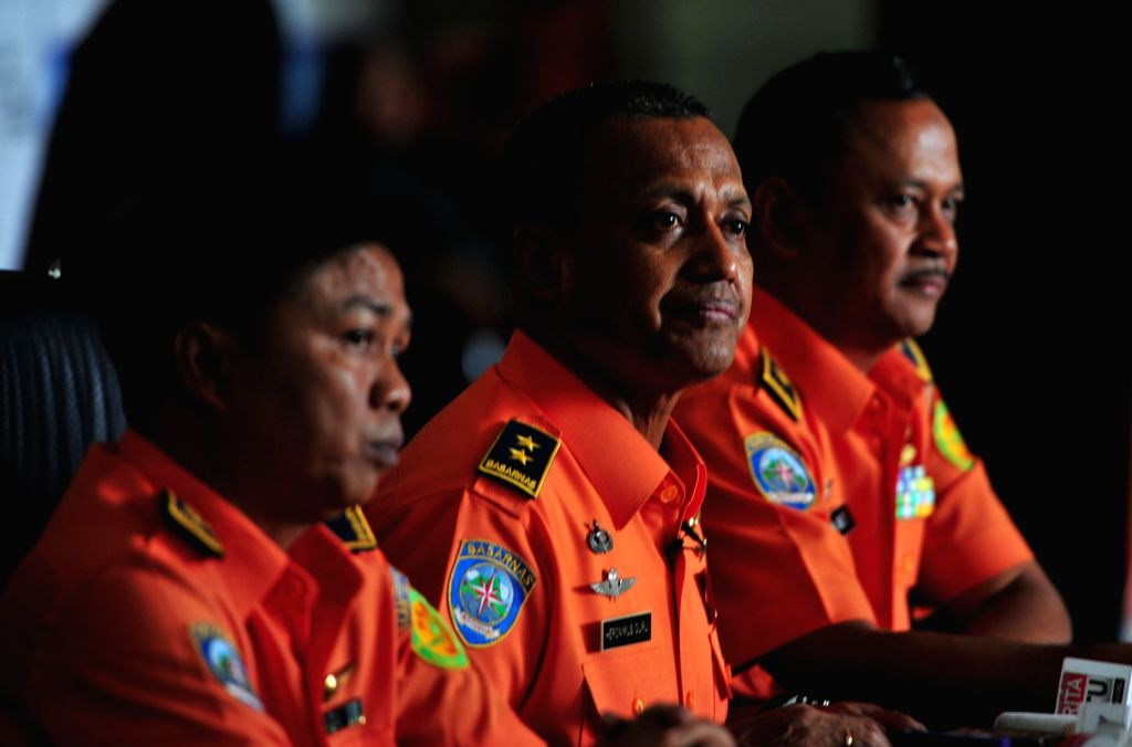 National Search and Rescue Agency (Basarnas) deputy operations director Heronimus Guru (C) speaks to media during a press conference in Jakarta, Indonesia, Aug. 18, ...