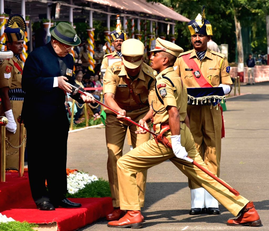 National Security Advisor Ajit Doval presents the IPS Association`s Sword of honour for the best outdoor officer trainee during the Passing Out Parade at Sardar Vallabhbhai Patel National ...