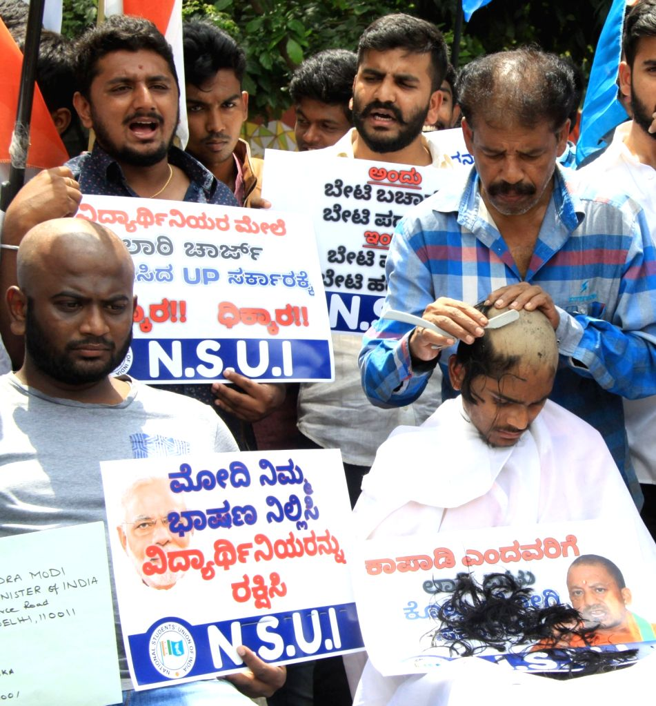 National Students' Union of India (NSUI) activists get their heads shaved to protest against police's violent lathi charge on protesting students of Banaras Hindu University (BHU) in ...