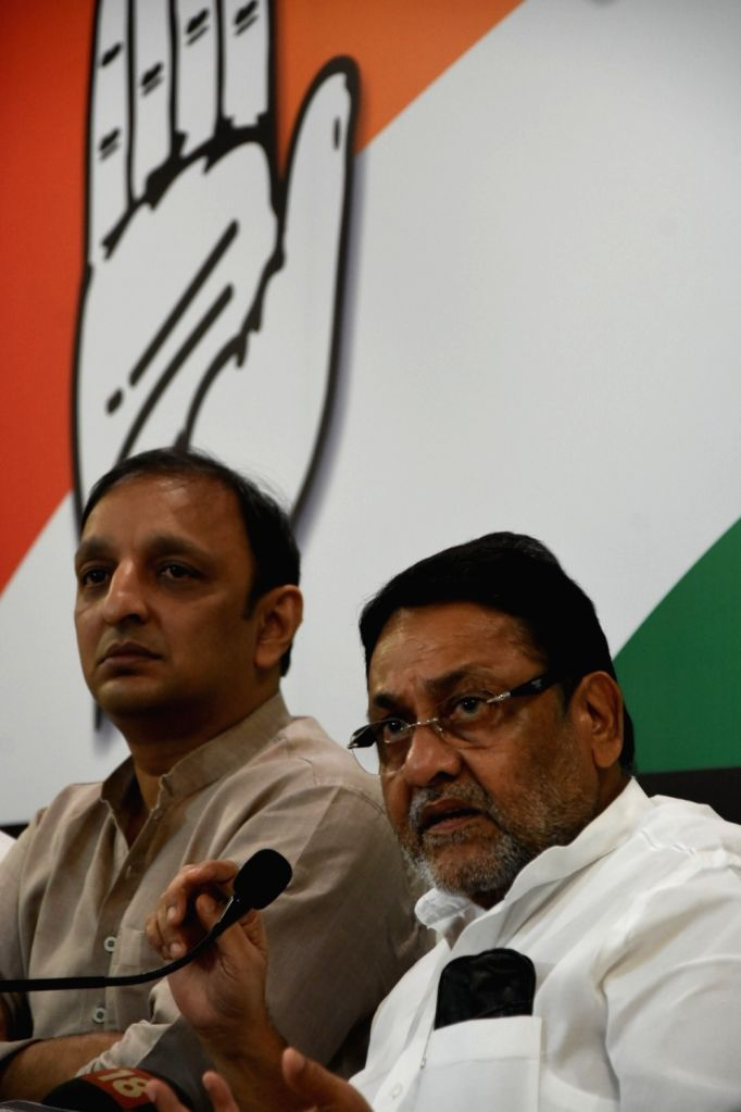 Nationalist Congress Party (NCP) leader Nawab Malik accompanied by Congress leader Sachin Sawant, addresses during a joint press conference in Mumbai on Sep 24, 2019. - Malik
