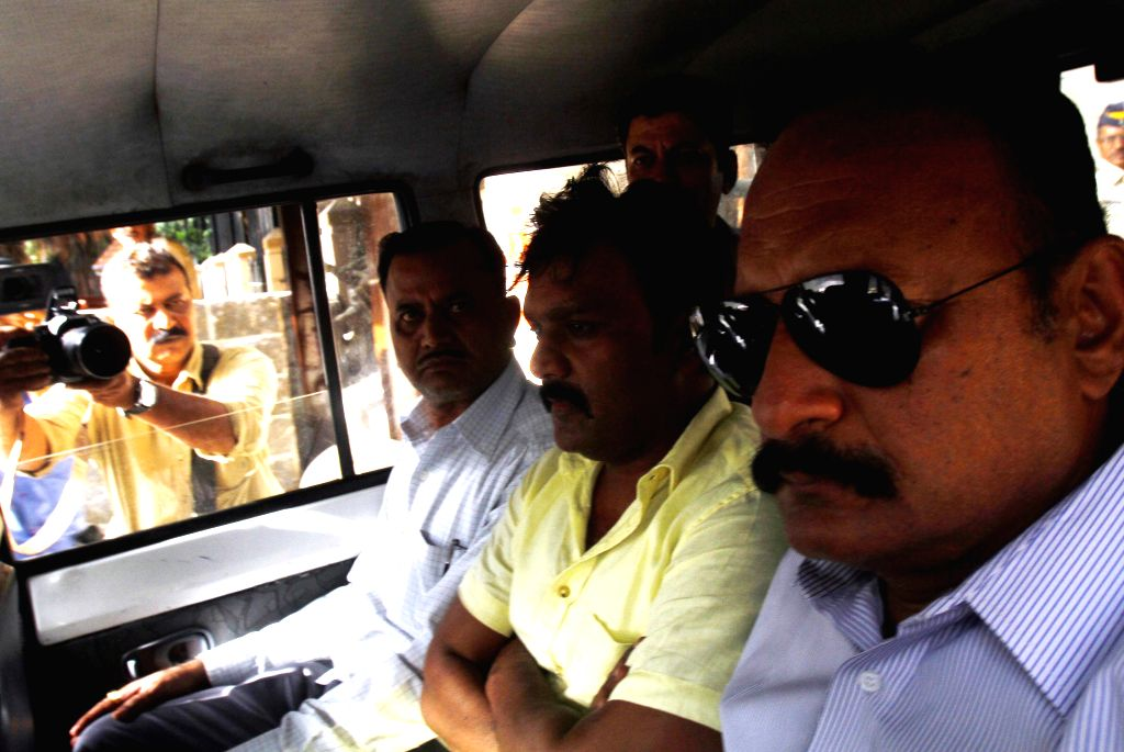 Nationalist Congress Party (NCP) legislator Ramesh Kadam being taken to be produced at a Mumbai Court for allegedly siphoning off Rs 141 crore from a state-run body, on Aug 17, 2015.