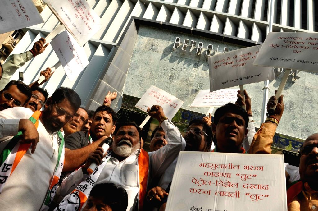 Nationalist Congress Party (NCP) workers stage a demonstration to press for their various demands, in Mumbai on April 3, 2018.