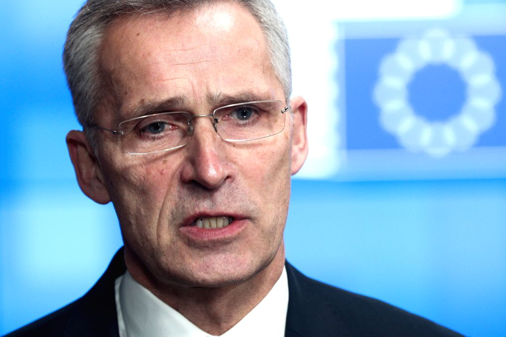 NATO Secretary General Jens Stoltenberg speaks to journalists as he arrives for an EU foreign ministers' meeting at the EU headquarters in Brussels, Belgium, Jan. ...