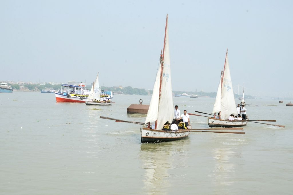 Naval Wing NCC Cadets approach Man-of-War Jetty after successful completion of their Sailing Expedition from Farakka to Kolkata; in Kolkata on Oct 28, 2015.