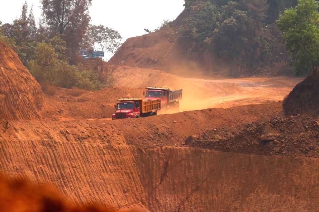 Navelim: A view of trucks moving amid mine fields near an iron plant at Navelim in Goa on March 13, 2018. BJP Goa MPs met the party's national president Amit Shah in the New Delhi on Tuesday and discussed the Supreme Court-imposed mining ban in Goa w - Amit Shah