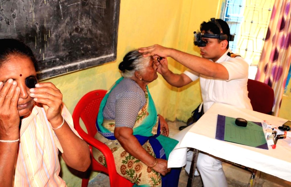 Navi Mumbai: Navy doctors during a Multi Specialty Medical Camp setup at Hanuman Koliwada in Navi Mumbai  on Oct 24, 2016.