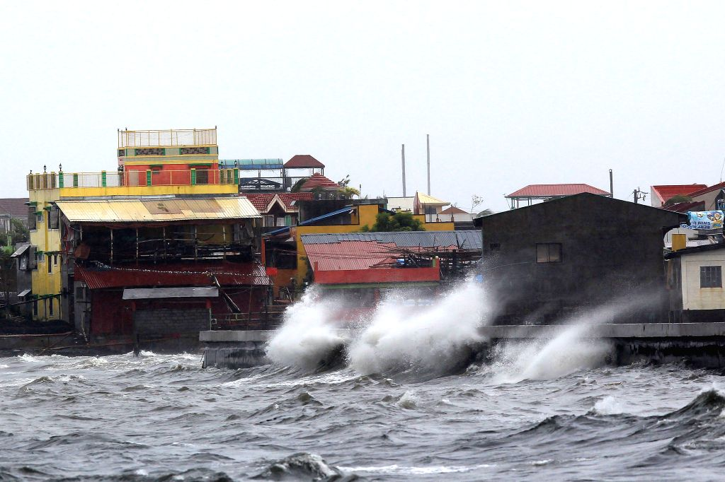 Waves splash in Navotas City, the Philippines, July 22, 2014. Alert levels have been raised in northern Philippines as Typhoon Matmo threatened to bring heavy .