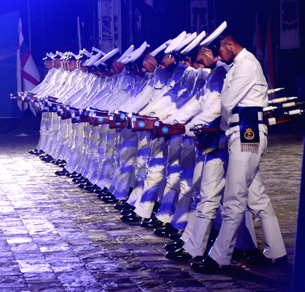 Navy personnel participate in the Beating Retreat ceremony on Navy Day at the Gateway of India in Mumbai on Dec 4, 2018.