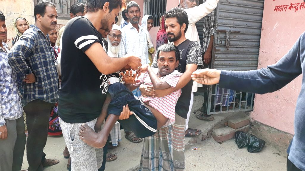 Nawada, Bihar: A disabled person being carried to a polling station to cast vote for Lok Sabha election in Nawada, Bihar on April 11, 2019.