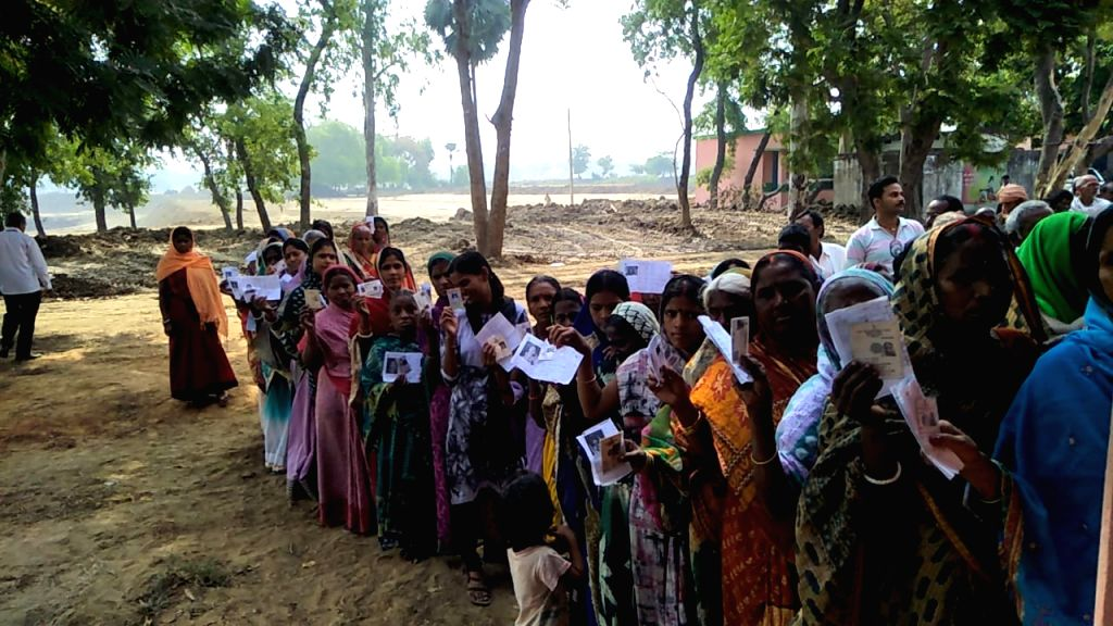 Nawada (Bihar): People stand in queue to cast their vote for 2019 Lok Sabha election at a polling station, in Nawada, Bihar, on April 11, 2019.