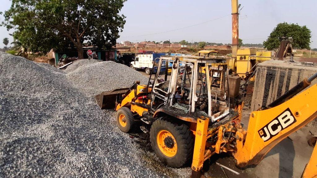 Naxalites attack on road construction company's base camp, JCB burnt.