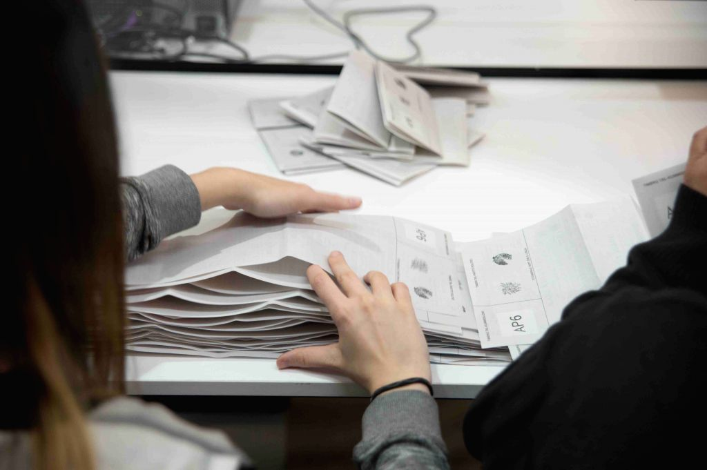 NAXXAR, May 27, 2019 - Officials sort ballots at a counting hall in Naxxar, Malta, on May 26, 2019. In Malta, polls closed after 10 p.m. local time (2000 GMT) on May 25, 2019 with 41 candidates ...
