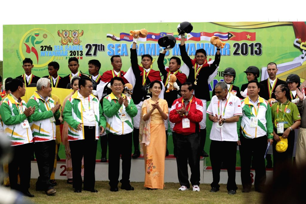Aung San Suu Kyi (C), leader of Myanmar's National League for Democracy (NLD), attends awarding ceremony of Equestrian Dressage Team competition at ...