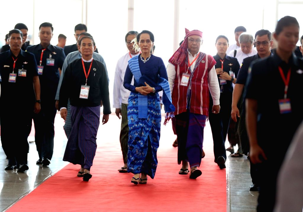 NAY PYI TAW, Feb. 13, 2018 - Myanmar's State Counselor Aung San Suu Kyi (C) arrives to attend the signing ceremony of Nationwide Ceasefire Accord at the Myanmar International Convention Center (MICC) ...