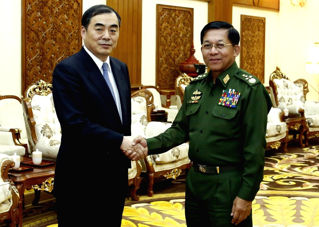 NAY PYI TAW, Jan. 17, 2018 - Commander-in-Chief of Myanmar's Defense Services Min Aung Hlaing (R) shakes hands with Chinese Vice Foreign Minister Kong Xuanyou during their meeting in Nay Pyi Taw, ... - Kong Xuanyou