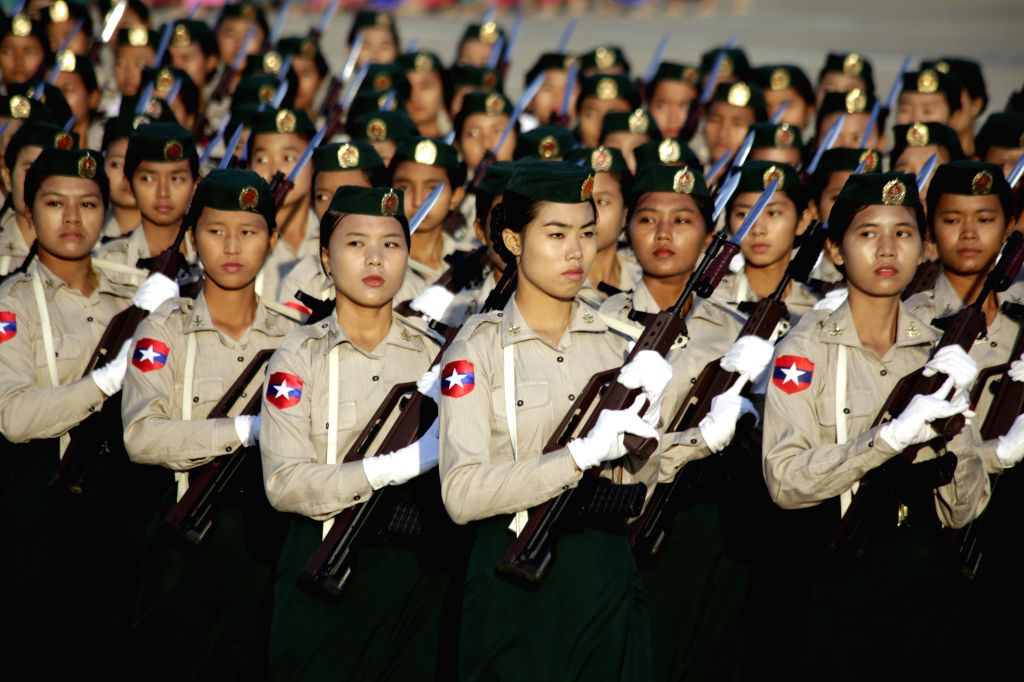Myanmar female soldiers participate in a ceremony to mark the 67th anniversary of Myanmar's Independence day in Nay Pyi Taw, Myanmar, Jan. 4, 2015. Myanmar ...