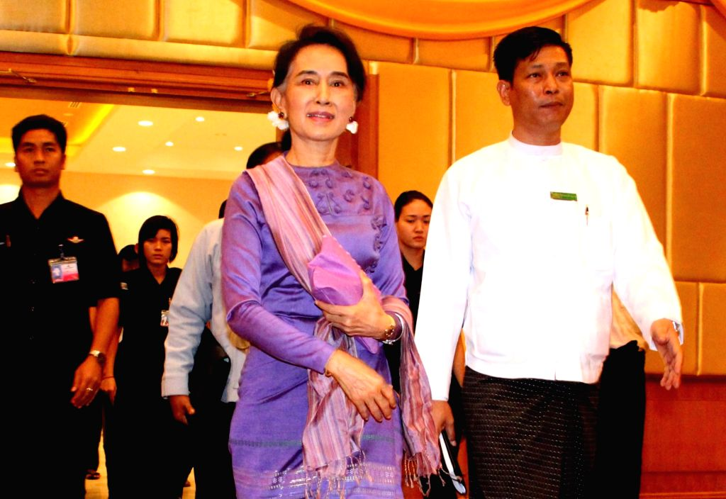 NAY PYI TAW, July 5, 2016 - Myanmar State Counselor Aung San Suu Kyi (L front) arrives to attend the meeting of Union Peace Dialogue Joint Committee (UPDJC) for ceasefire in Nay Pyi Taw, Myanmar, ...