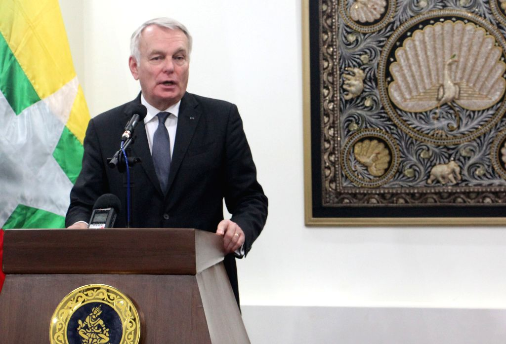 NAY PYI TAW, June 17, 2016 - French Minister for Foreign Affairs and International Development Jean-Marc Ayrault speaks during a joint press conference with Myanmar's State Counselor and Foreign ... - Aung San Suu Kyi
