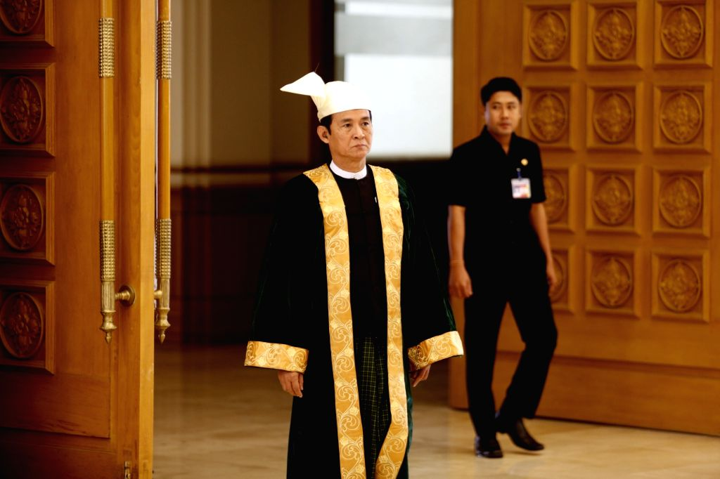 NAY PYI TAW, March 21, 2018 - Photo taken on March 11, 2016 shows Myanmar Parliament Speaker U Win Myint leaves from the House of Representatives (Lower House) in Nay Pyi Taw, Myanmar. Myanmar ... - U Win Myint
