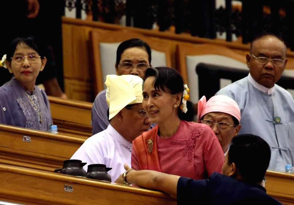 NAY PYI TAW, March 28, 2018 - Myanmar State Counselor Aung San Suu Kyi (C) attends a session of Myanmar Union Parliament in Nay Pyi Taw, Myanmar, March 28, 2018. U Win Myint, former speaker of the ...