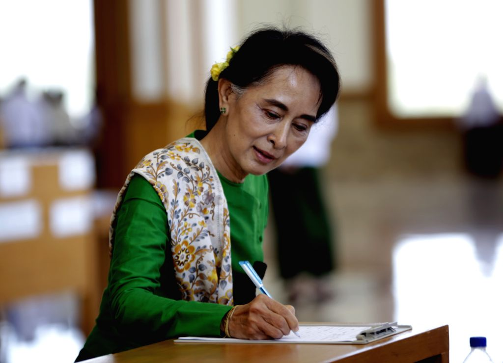 Nay Pyi Taw (Myanmar): Aung San Suu Kyi, leader of Myanmar's National League for Democracy (NLD), signs registration forms to attend the 11th regular session of the Union Parliament in Nay Pyi Taw, ..