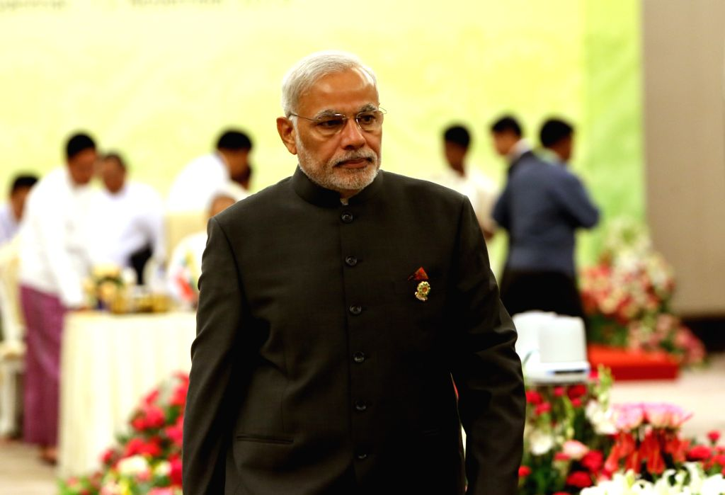 Nay Pyi Taw (Myanmar): Indian Prime Minister Narenda Modi walks to his seat ahead of the 12th ASEAN-INDIA Summit in Nay Pyi Taw, Myanmar, Nov. 12, 2014.  ****Authorized by ... - Narenda Modi