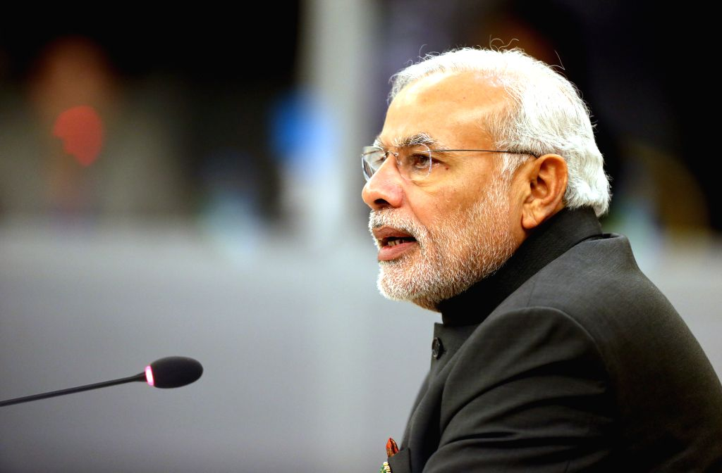Nay Pyi Taw (Myanmar): Indian Prime Minister Narenda Modi delivers a speech during the 12th ASEAN-INDIA Summit in Nay Pyi Taw, Myanmar, Nov. 12, 2014. - Narenda Modi