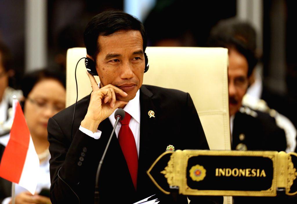 Nay Pyi Taw (Myanmar): Indoneisan President Joko Widodo attends the 12th ASEAN-INDIA Summit in Nay Pyi Taw, Myanmar, Nov. 12, 2014.