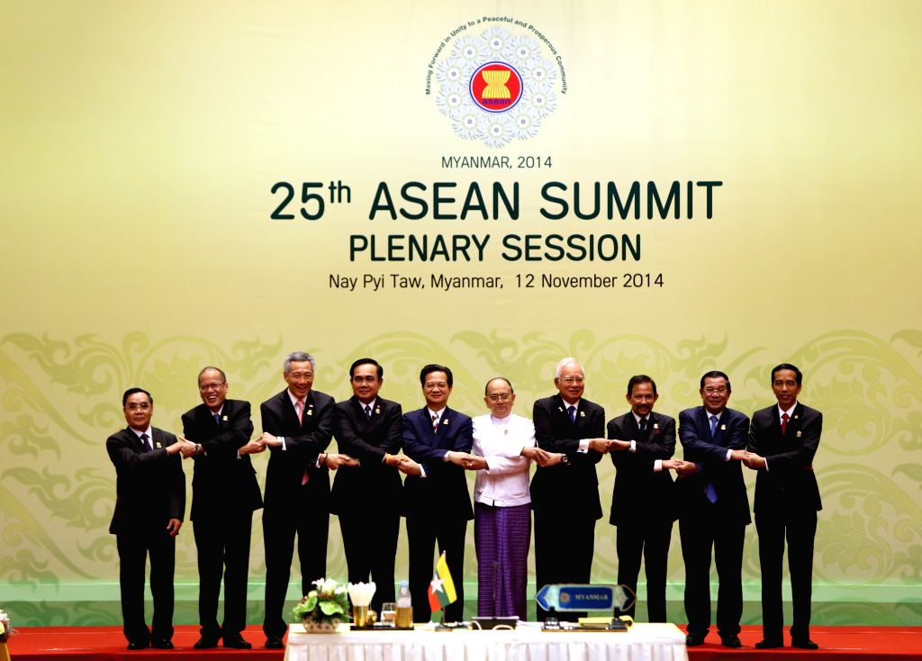 Nay Pyi Taw (Myanmar): Leaders pose for a group photo before the opening of the 25th ASEAN summit in Nay Pyi Taw, Myanmar, Nov. 12, 2014. ASEAN leaders on Wednesday adopted a declaration on the ASEAN