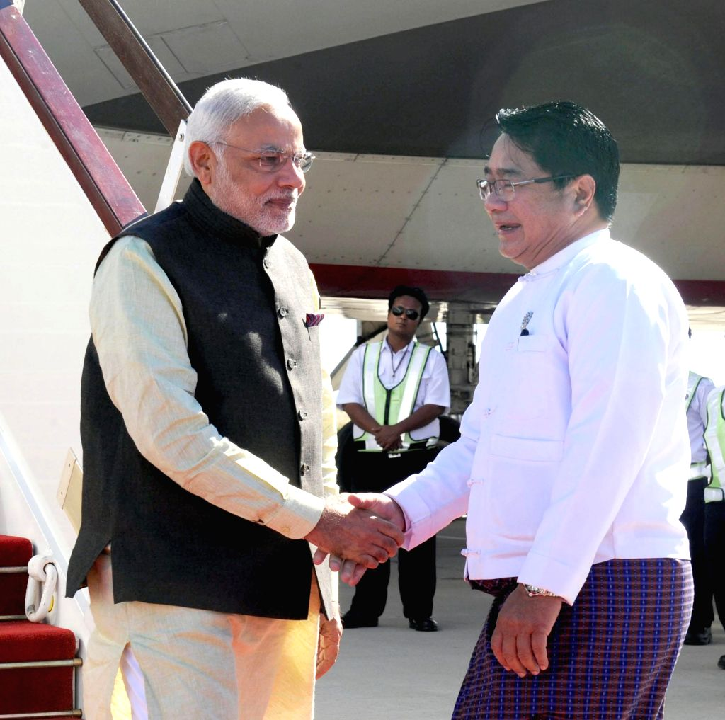 Nay Pyi Taw: Prime Minister Narendra Modi being received by the Health Minister of Myanmar  Than Aung on his arrival in Nay Pyi Taw, Myanmar on Nov 11, 2014. - Narendra Modi