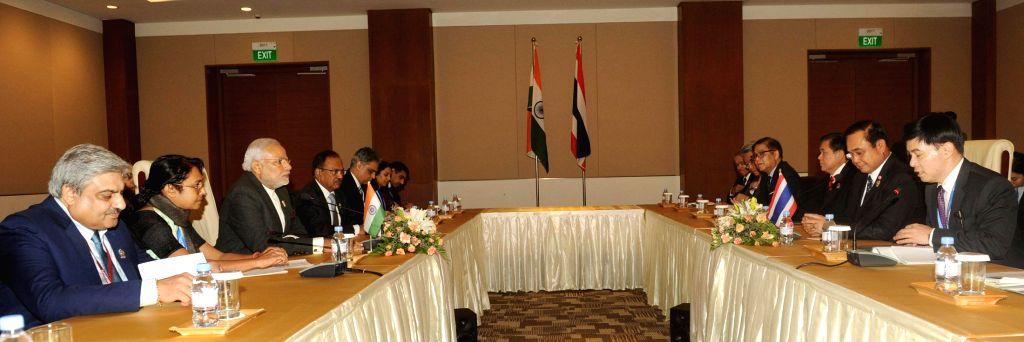 Nay Pyi Taw: Prime Minister Narendra Modi during a meeting with the Prime Minister of Thailand, Gen. Prayut Chan-o-cha, at Nay Pyi Taw, Myanmar on Nov 12, 2014. - Narendra Modi