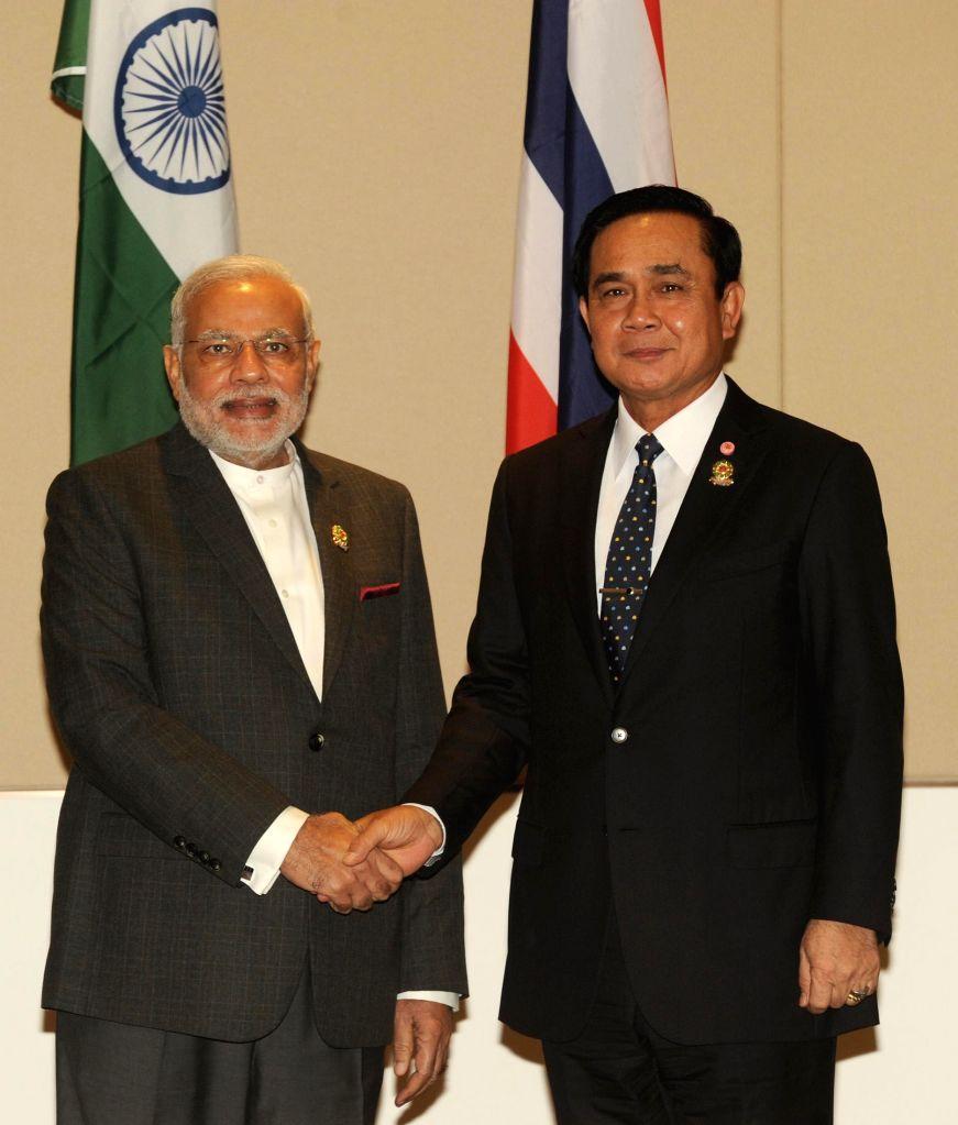 Nay Pyi Taw: Prime Minister Narendra Modi meets the Prime Minister of Thailand, Gen. Prayut Chan-o-cha, at Nay Pyi Taw, Myanmar on Nov 12, 2014. - Narendra Modi