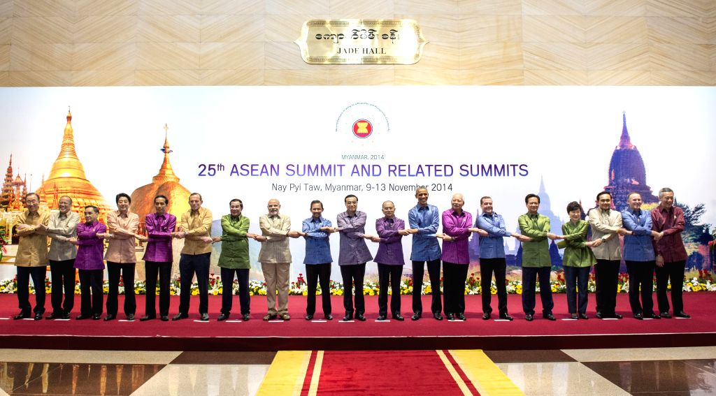 Nay Pyi Taw: Prime Minister Narendra Modi poses for a group photo with other leaders attending the East Asia Summit before the welcome banquet at Nay Pyi Taw, Myanmar, Nov. 12, 2014. Modi attended ... - Narendra Modi