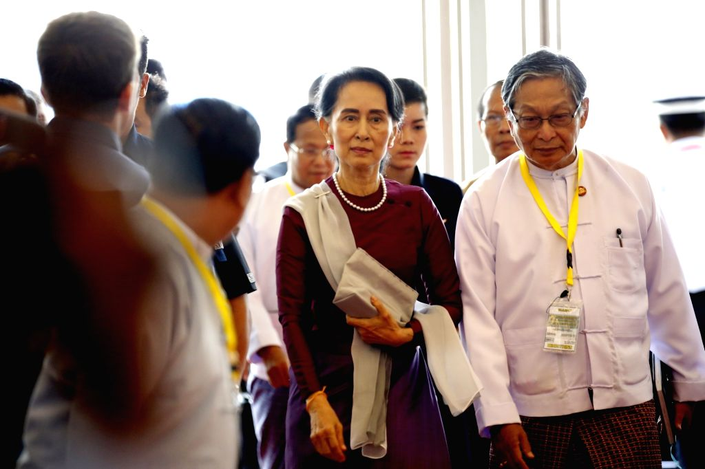 NAY PYI TAW, Sept. 19, 2017 - Myanmar State Counselor Aung San Suu Kyi (C) arrives to deliver a speech at the Myanmar International Convention Center-2 in Nay Pyi Taw, Myanmar, Sept. 19, 2017. Aung ...