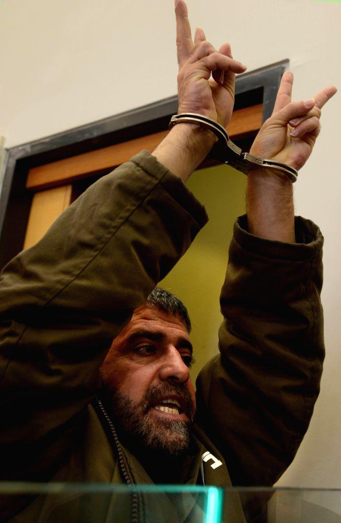 NAZARETH (ISRAEL), March 27, 2015 Sedki al-Maket reacts at the Nazareth District court in Nazareth, northern Israel, on March 27, 2015. Sedki al-Maket, a Druze from Israeli-held Golan ...