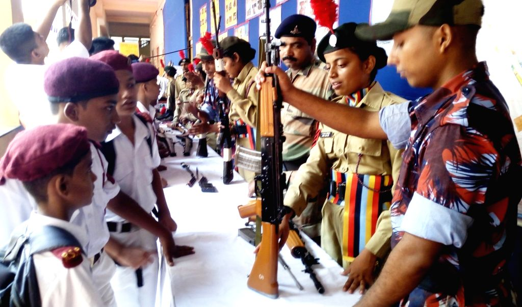 NCC students of South Indian Education Society organise an exhibition of war equipments in the college premises in Mumbai on July 31, 2017.
