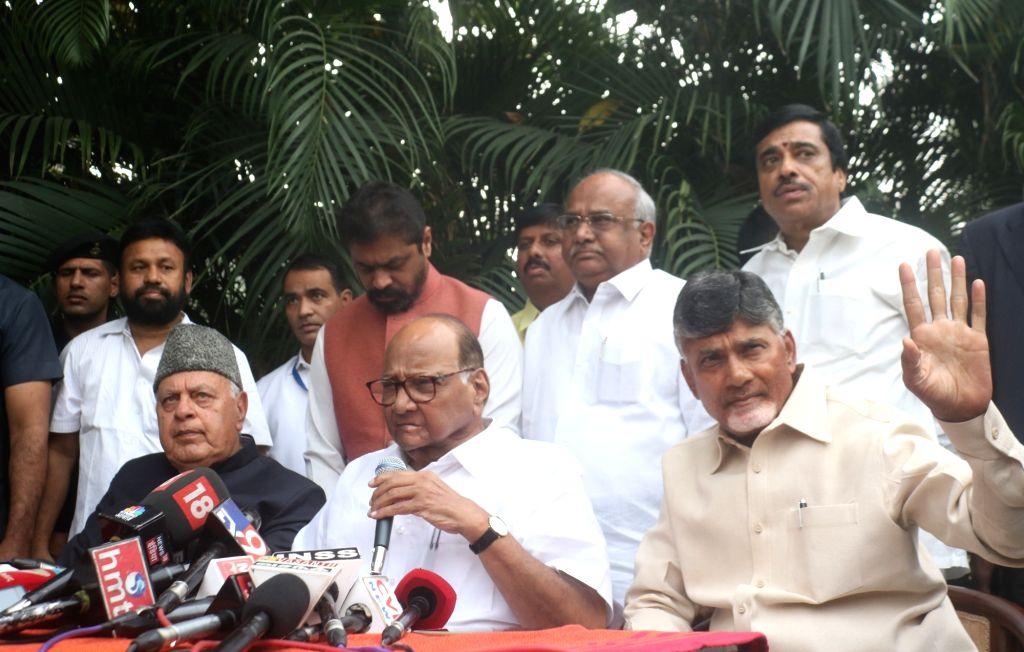 NCP chief Sharad Pawar accompanied by Andhra Pradesh Chief Minister and Telugu Desam Party (TDP) chief N. Chandrababu Naidu and National Conference president Farooq Abdullah during a media ... - N. Chandrababu Naidu