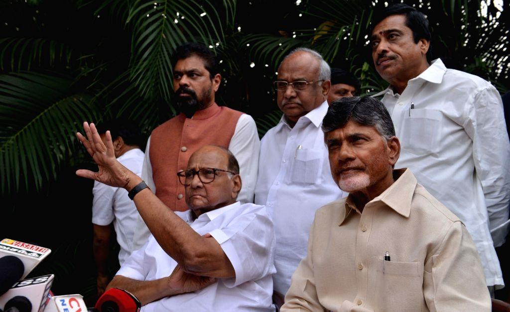 NCP chief Sharad Pawar accompanied by Andhra Pradesh Chief Minister and Telugu Desam Party (TDP) chief N. Chandrababu Naidu talks to the media in New Delhi, on Nov 1, 2018. - N. Chandrababu Naidu