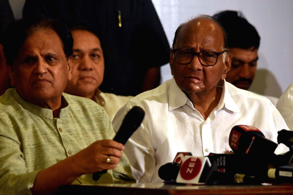 NCP chief Sharad Pawar and Congress leader Ahmed Patel during a joint press conference, in Mumbai on Nov 12, 2019. - Ahmed Patel