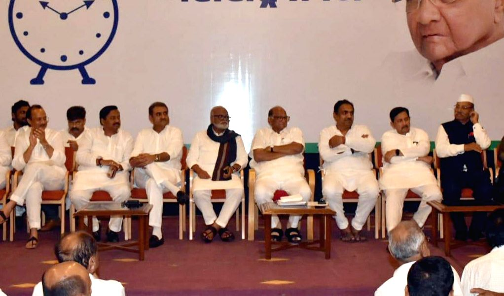 NCP Chief Sharad Pawar and party leaders Ajit Pawar, Chhagan Bhujbal and other leaders during a party meeting of senior leaders and legislators to discuss the government formation issue in ...