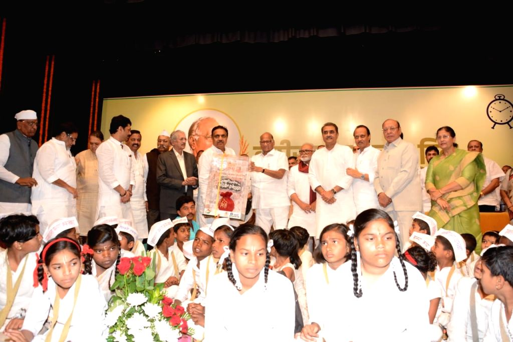 NCP chief Sharad Pawar being greeted during his 80th birthday celebrations in Mumbai on Dec 12, 2019. Also seen NCP leaders Ajit Pawar, Chhagan Bhujbal and Praful Patel. - Praful Patel