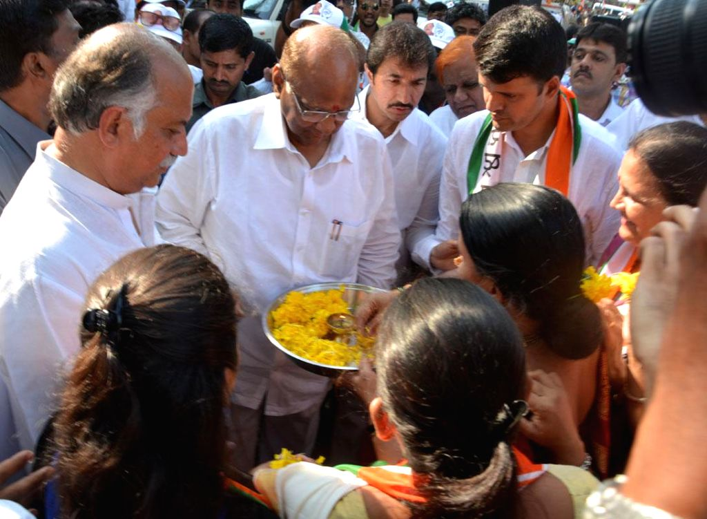 NCP chief Sharad Pawar campaigns for Congress for 2014 Lok Sabha Election from Mumbai North West constituency, Gurudas Kamat in Mumbai on April 22, 2014.